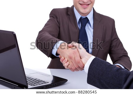 Conclusion of job interview - two young men shaking hands - stock photo