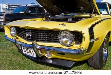 CONCORD, NC -- APRIL 11, 2015:  A 1969 Chevy Camaro SS automobile on display at the Charlotte AutoFair classic car show held at Charlotte Motor Speedway. - stock photo