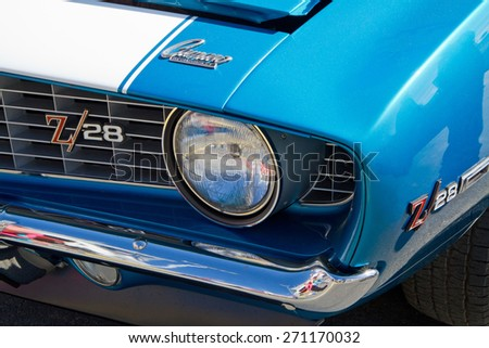 CONCORD, NC -- APRIL 11, 2015:  A 1969 Chevy Z/28 Camaro automobile on display at the Charlotte AutoFair classic car show held at Charlotte Motor Speedway. - stock photo