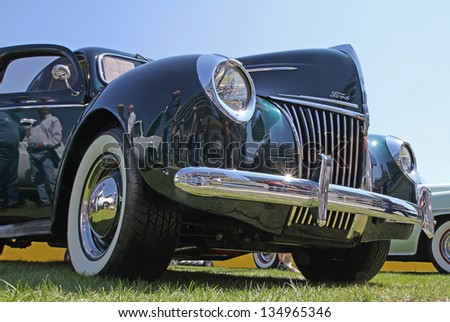 CONCORD, NC - APRIL 6:  A 1939 Ford Deluxe Coupe automobile on display at the Food Lion Auto Fair classic car show at Charlotte Motor Speedway in Concord, NC, April 6, 2013. - stock photo