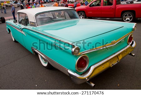 CONCORD, NC -- APRIL 11, 2015:  A 1959 Ford Skyliner automobile on display at the Charlotte AutoFair classic car show held at Charlotte Motor Speedway.  - stock photo