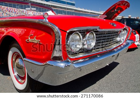 CONCORD, NC -- APRIL 11, 2015:  A 1960 Ford Sunliner automobile on display at the Charlotte AutoFair classic car show held at Charlotte Motor Speedway. - stock photo