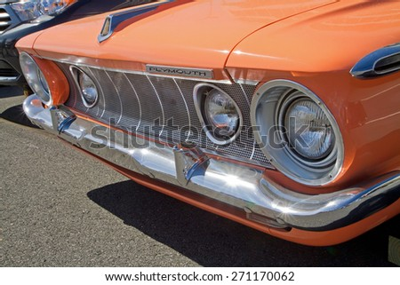 CONCORD, NC -- APRIL 11, 2015:  A 1962 Plymouth Fury automobile on display at the Charlotte AutoFair classic car show held at Charlotte Motor Speedway. - stock photo