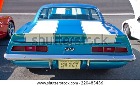 CONCORD, NC -- SEPTEMBER 20, 2014:  A 1969 Chevy Camaro SS automobile on display at the Charlotte AutoFair classic car show held at Charlotte Motor Speedway. - stock photo