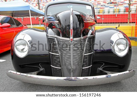 CONCORD, NC - SEPTEMBER 21:  A 1940 Ford on display at the Charlotte Auto Fair classic car show at Charlotte Motor Speedway in Concord, North Carolina, September 21, 2013. - stock photo