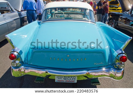CONCORD, NC -- SEPTEMBER 20, 2014:  A 1960 Studebaker Hawk automobile on display at the Charlotte AutoFair classic car show held at Charlotte Motor Speedway. - stock photo