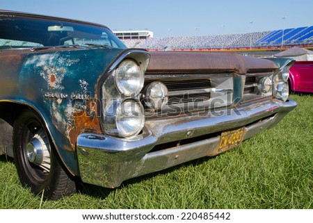 CONCORD, NC -- SEPTEMBER 20, 2014:  An unrestored 1963 Pontiac Grand Prix automobile on display at the Charlotte AutoFair classic car show held at Charlotte Motor Speedway.