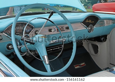 CONCORD, NC - SEPTEMBER 21:  Interior of a 1955 Chevy Bel Air on display at the Charlotte Auto Fair classic car show at Charlotte Motor Speedway in Concord, North Carolina, September 21, 2013. - stock photo