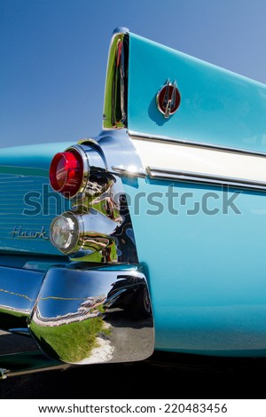 CONCORD, NC -- SEPTEMBER 20, 2014:  Tail fin of a 1960 Studebaker Hawk automobile on display at the Charlotte AutoFair classic car show held at Charlotte Motor Speedway. - stock photo
