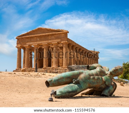 Concordia temple with beautiful sky and statue of angel in front  in the Valley of the Temples, Agrigento, Sicily island, Italy - stock photo