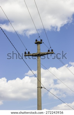 Concreet electrical pole with power lines 2 and sky background. Selective focus. - stock photo