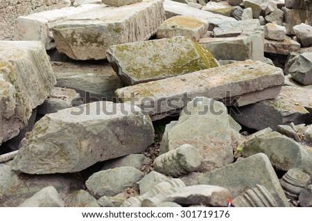 Concrete and brick rubble debris on construction site - stock photo