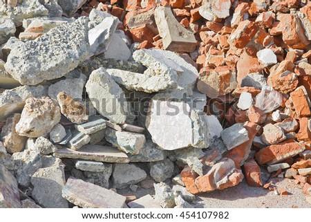 Concrete and brick rubble debris on construction site after a demolition of a building - stock photo