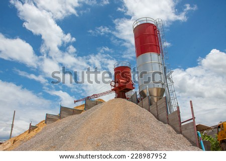 concrete batching plant, heap of sand and gravel, cement material stationary - stock photo