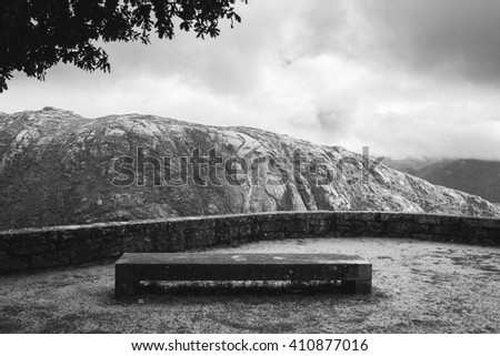 Concrete bench in front of a granite hill in Portugal - stock photo