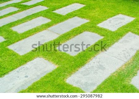 Concrete block on grass - stock photo