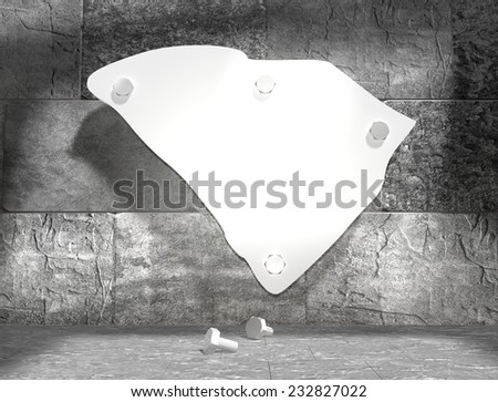 concrete blocks empty room with clear outline south carolina state map attached to wall by bolts - stock photo
