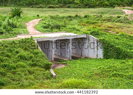 Concrete bridge and irrigation canal in farm