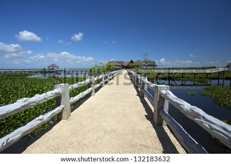 Concrete bridge over river - stock photo