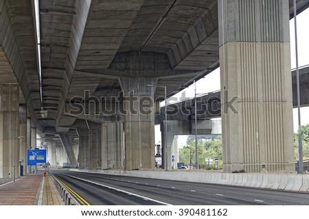 Concrete bridge pillars under view - stock photo