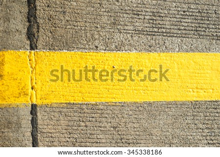 Concrete floor with traffic yellow line