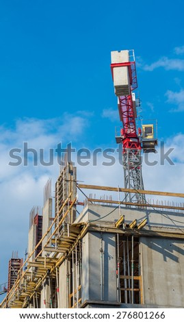 Concrete formwork, reinforcing bars and crane on the office building construction site