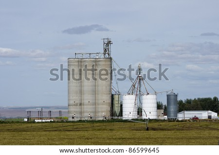 Concrete grain storage silos with elevators - stock photo