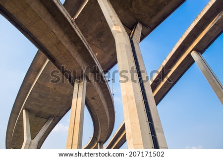 Concrete highway overpass Bhumibol Bridge in Thailand. The bridge crosses the Chao Phraya River twice. - stock photo