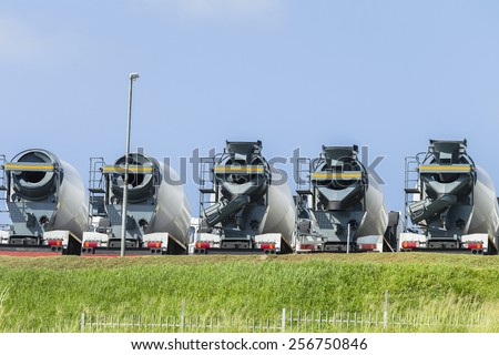 Concrete Mixer Truck Vehicles New  concrete cement ready mixer mobile truck vehicles for the building industry - stock photo