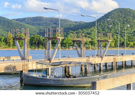concrete pier and port for rowing boat  - stock photo