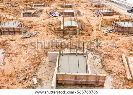 Concrete pillar construction in site,Temporary wood forms are used to form concrete poured in place for foundation