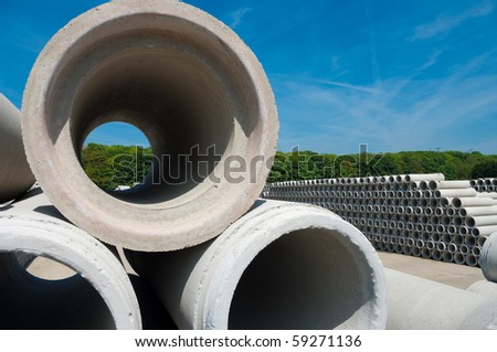 concrete pipes on a large storage area. They are used for culverts