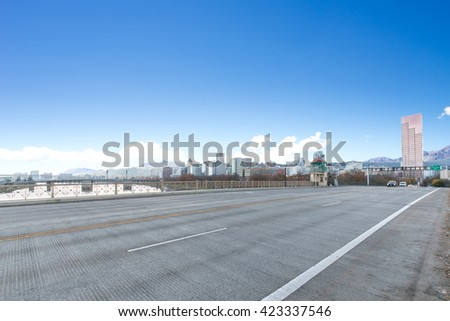 concrete road near water with cityscape and skyline of portland - stock photo
