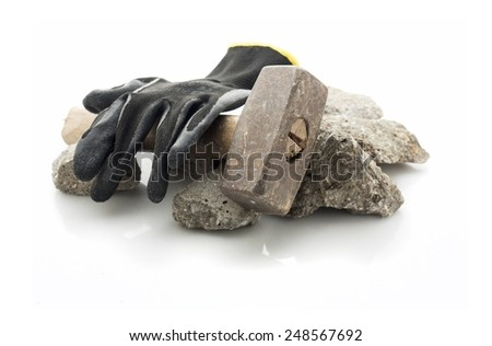 Concrete rubble debris with hammer and gloves  isolated on white - stock photo
