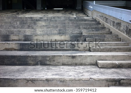 Concrete seating stand at horse racing track.