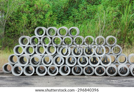 Concrete sewage pipes stored in a factory yard