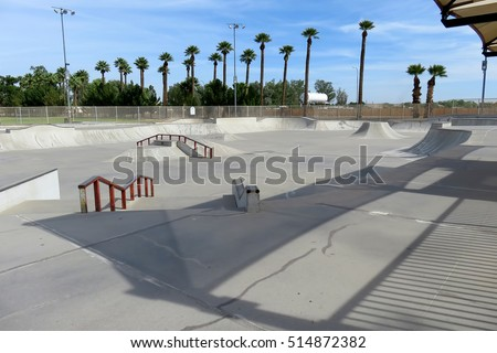 Concrete skate park with grind rails and quarter pipe