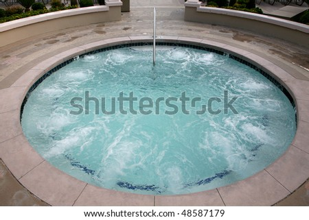 Concrete spa or whirlpool - stock photo