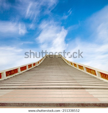 concrete staircase going up into a blue sky - stock photo
