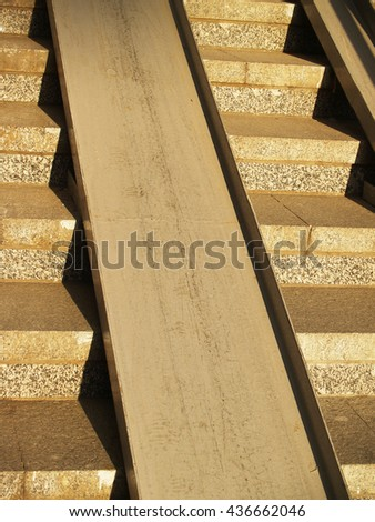 Concrete stairway with metallic ramp for wheelchairs and pushchairs - stock photo