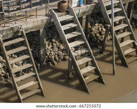 Concrete steps leading to the canal at the floating market of Amphawa, Thailand