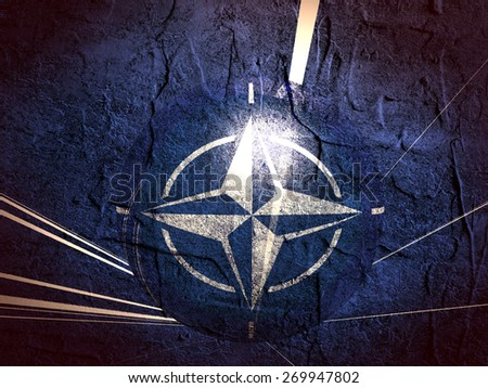concrete textured wall and sphere textured by nato flag - stock photo