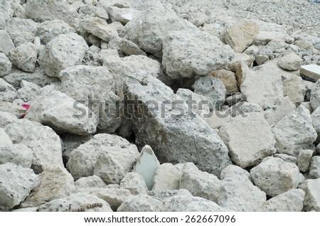 Concrete Wall and Brick Rubble Debris on Construction Site - stock photo