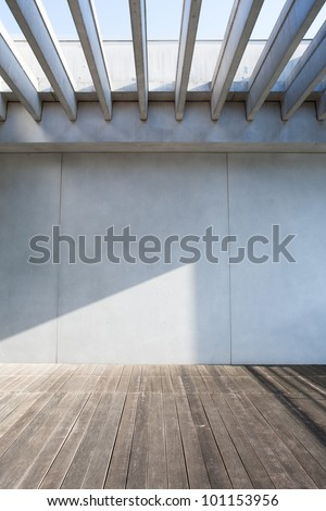 concrete wall and wood deck - stock photo