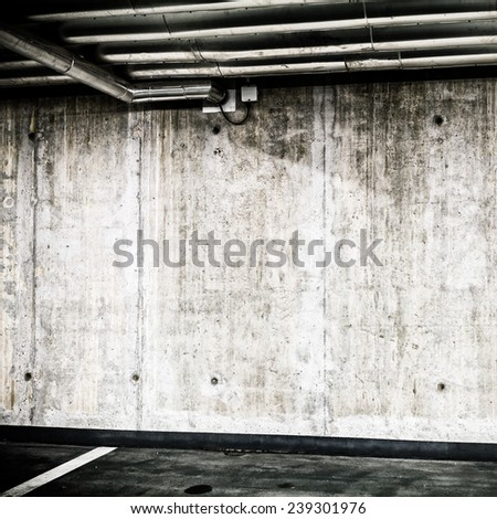 Concrete Wall Construction in Parking Garage Underground Interior background or texture. Concrete grunge wall, industrial retro vintage interior. - stock photo