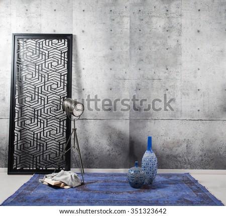 concrete wall interior decor and blue rug - stock photo
