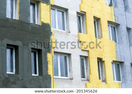 Concrete wall of building with insulation for thermal protection - stock photo