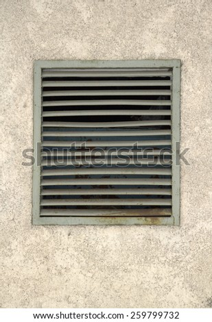 concrete wall with metal bars - stock photo