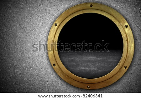 concrete wall with porthole - stock photo