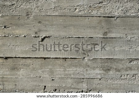 Concrete wall with wooden pattern impress from wooden form board shuttering and with sags of cement concrete - stock photo